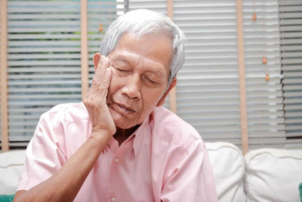 patient suffering with tooth sensitivity
