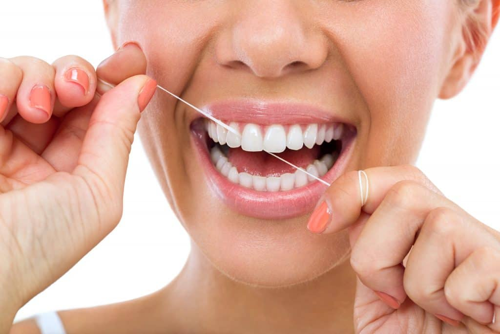 lady smiling and flossing