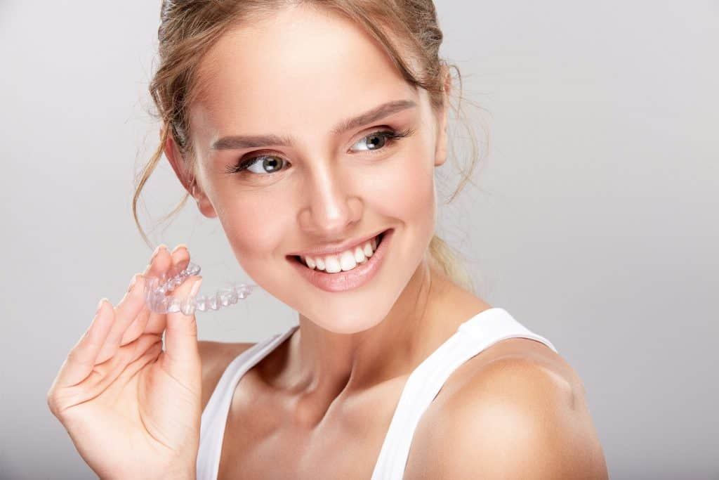 a lady smiling wearing invisalign